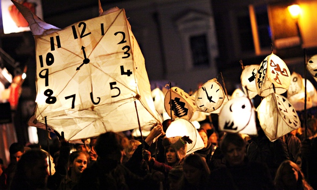 Revellers take part in the annual Burning the Clocks Winter Solstice Parade through Brighton