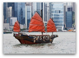 Modern Hong Kong with an old style sail ship