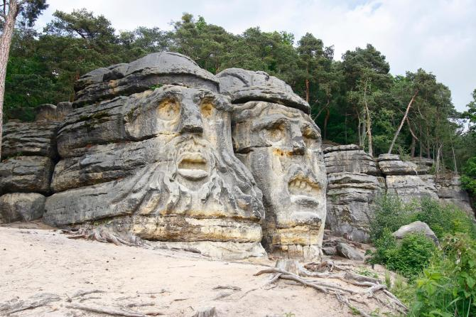 Heads of Devils are about 9 m high rock sculptures of giant heads carved into the sandstone cliffs in the pine forest above the village Zelizy in the district Melnik, Czech republic. It is the work of sculptor Vaclav Levy, who created in the period 1841-1846.